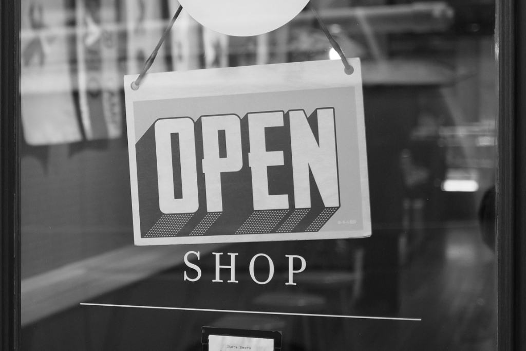 Photo of 'Open shop' sign by Mike Petrucci on Unsplash