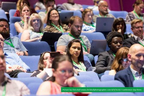 People at the Annual Conference, listening to a presentation